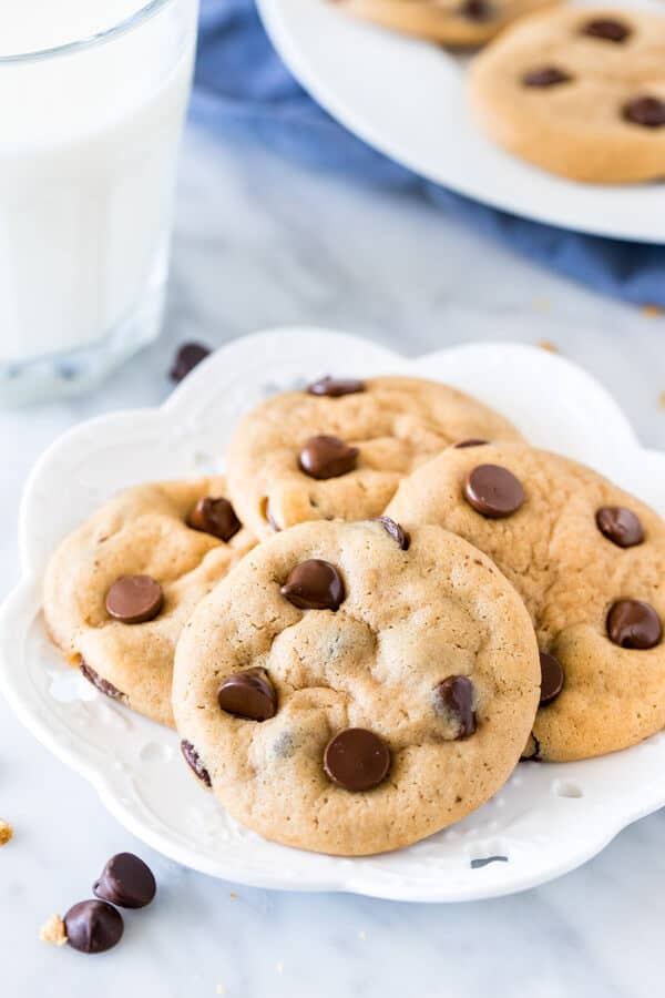 Plate of cream cheese chocolate chip cookies with a glass of milk.