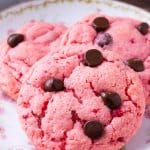 Strawberry cookies are soft and gooey. They're made with cake mix so they're super easy and filled with chocolate chips.