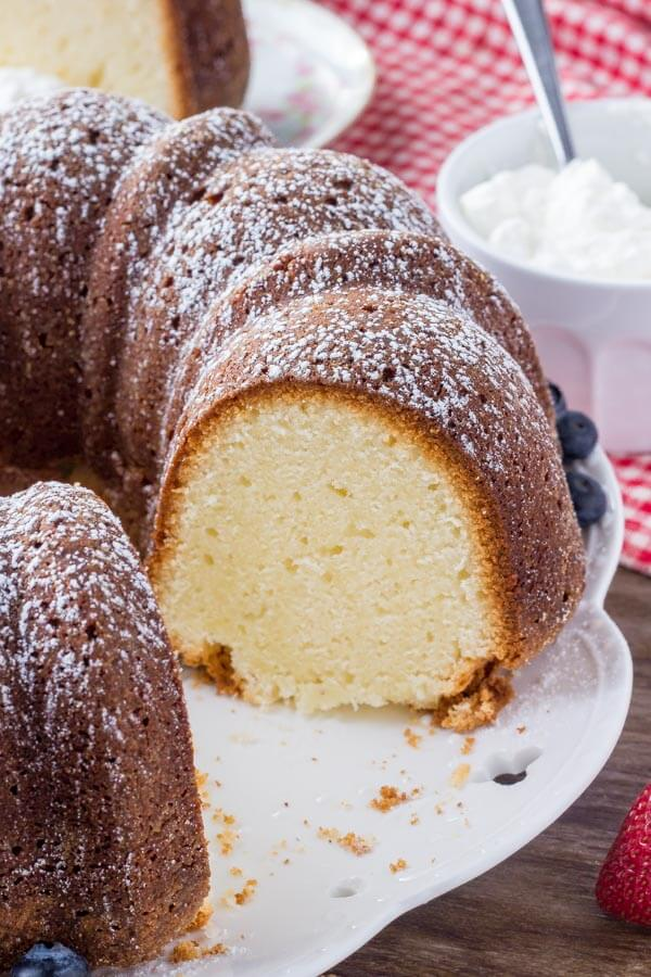 Cream Cheese Pound Cake with a sprinkle of powdered sugar makes for an easy, elegant, delicious dessert.