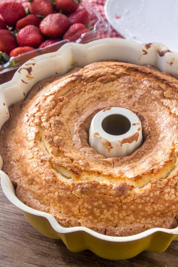 Cream cheese pound cake freshly baked with golden edges.