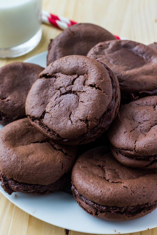 These homemade Fudgee-O cookies are extra soft, super chocolate-y, and seriously addictive. It's an easy chocolate cake mix cookie recipe, then they're sandwiched creamy chocolate frosting.