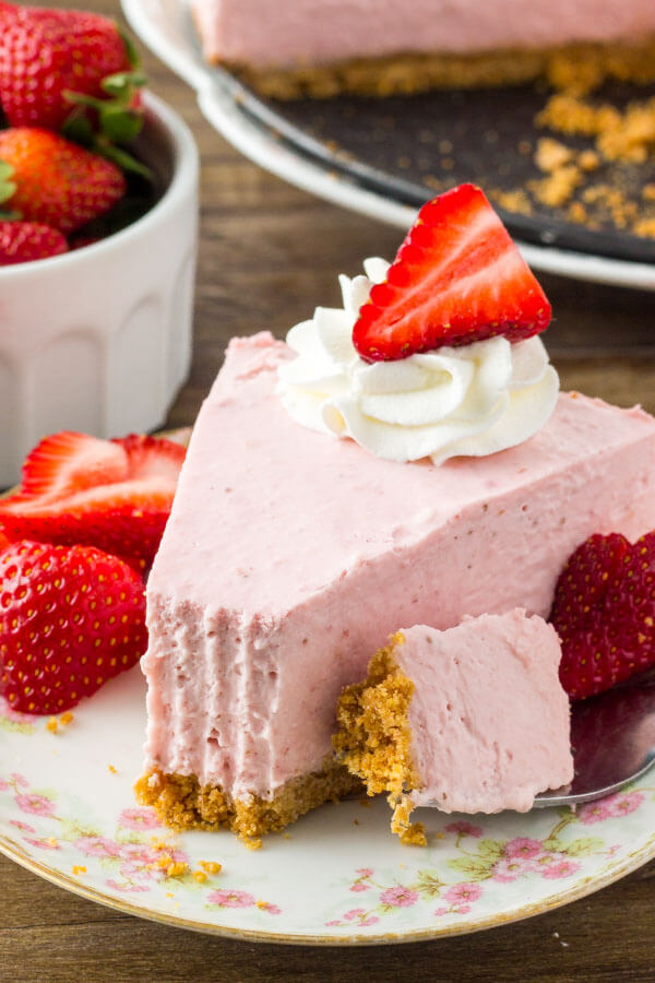 Easy strawberry no bake cheesecake - extra creamy, bursting with strawberries, and so delicious.