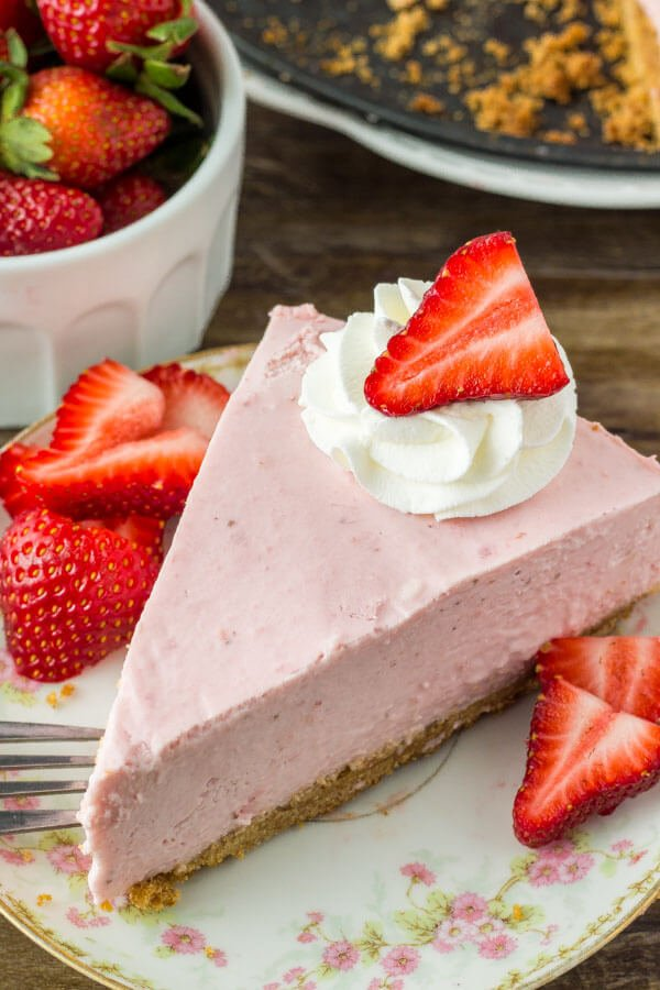 This no bake strawberry cheesecake is extra creamy and bursting with strawberries. It's a super easy to make and turns out with a luscious texture, crunchy graham cracker crust, and delicious strawberry flavor that no one can resist!