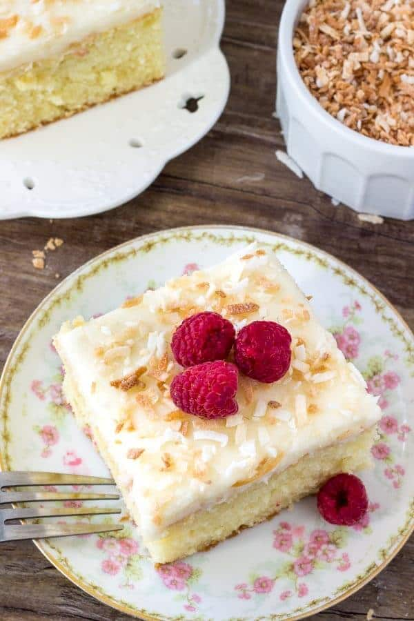 Homemade coconut cake is tender and moist with a delicious coconut flavor and fluffy coconut frosting