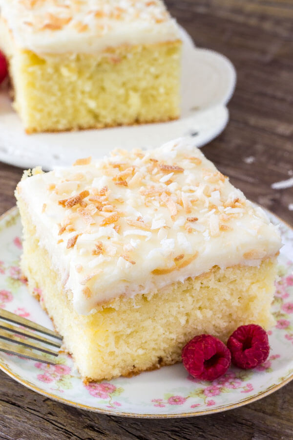 Easy coconut cake with coconut frosting. This recipe is extra moist and infused with real coconut flavor.