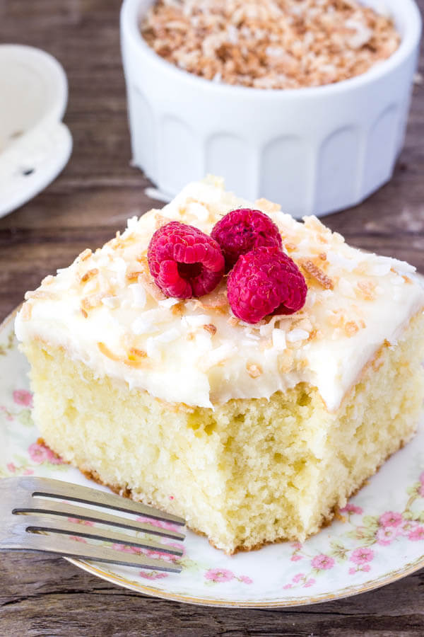 Coconut Cake with Coconut Frosting - moist, tender and filled with real coconut flavor. Topped with coconut frosting and toasted coconut.