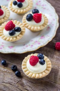 Mini fruit tarts with buttery pastry, creamy vanilla filling, and fresh berries. This recipe is so easy and perfect for entertaining.