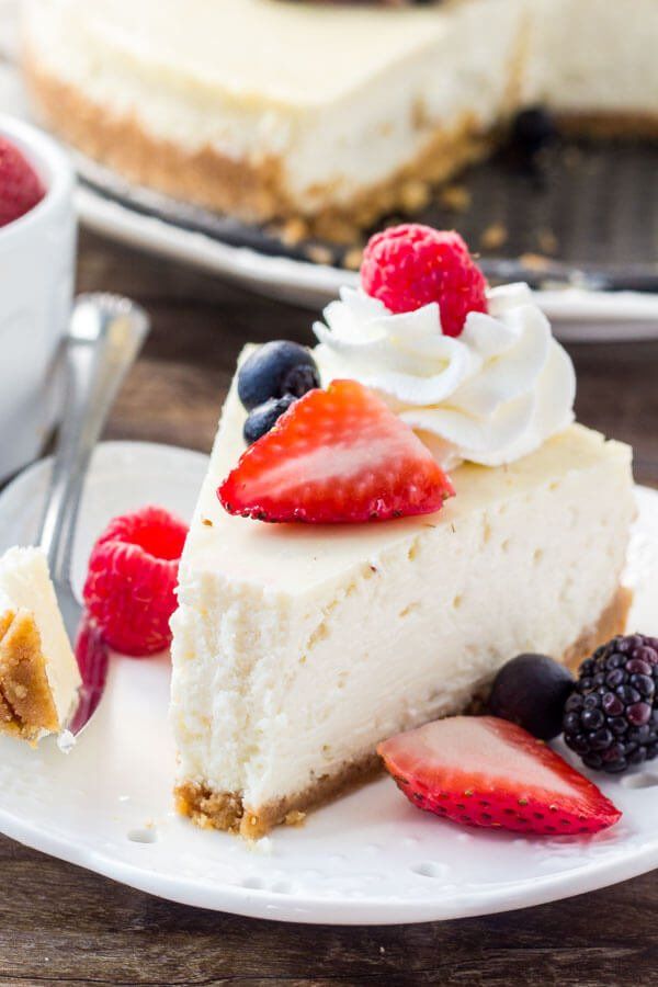 Classic New York Cheesecake Recipe - this is as good as it gets! Creamy, smooth, super decadent, with a deliciously tangy, creamy flavor.