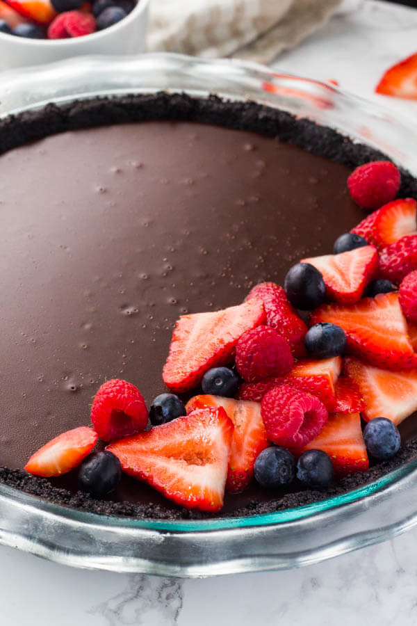 Easy chocolate pie that's super fudgy and rich makes for the perfect dinner party dessert.