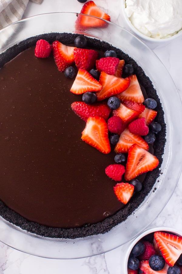 No bake chocolate pie with a graham cracker crust, and thick fudgy chocolate ganache.