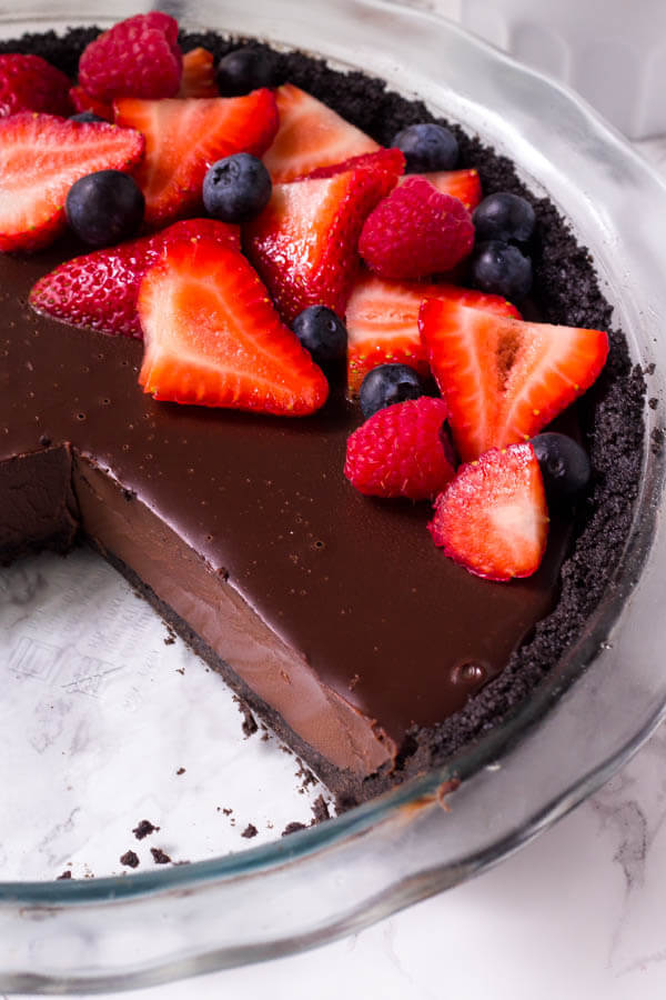 No bake chocolate pie has a delicious Oreo crust and rich chocolate fudge filling for the ultimate chocolate pie recipe.