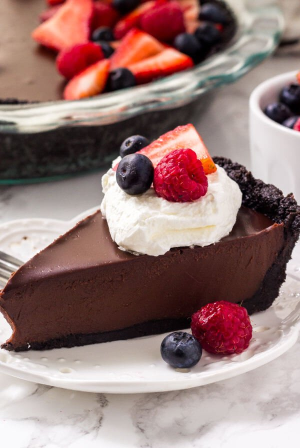 This no bake chocolate pie is rich, fudgy, and seriously delicious. The crust is no bake and made with Oreo cookies. Then the filling is a chocolate ganache that's silky smooth