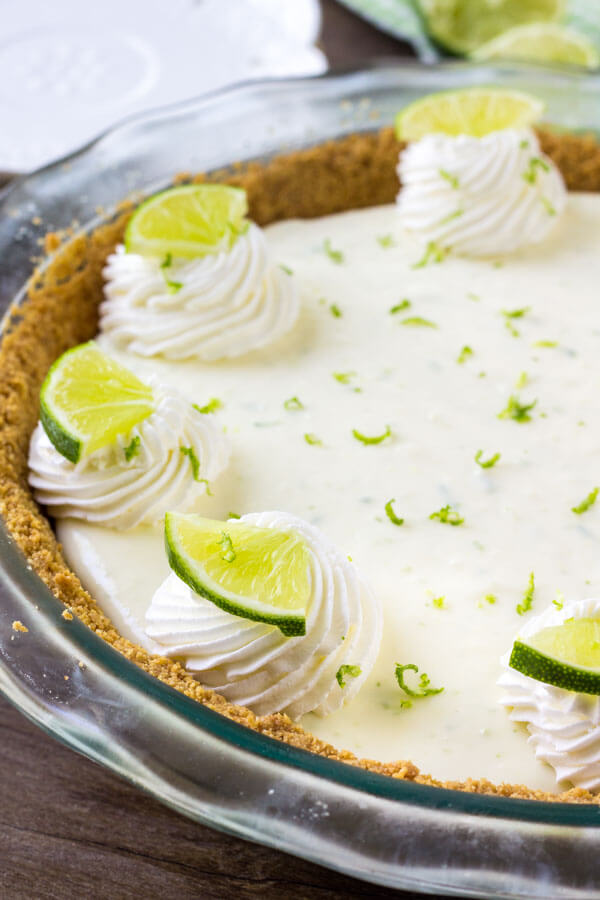 This no bake key lime pie is the perfect easy pie recipe for summer. It has a crunchy graham cracker crust, and a creamy filling with a delicious tanginess thanks to fresh lime juice and zest.