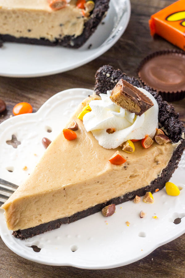 No bake peanut butter pie is extra rich, super creamy, and so easy to make. Oreo crust, peanut butter filling, and topped with peanut butter cups and whipped cream.