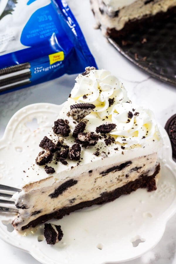 This homemade Oreo Ice Cream Cake is the perfect summer dessert for birthday parties and BBQs. It has a fudgy brownie bottom, creamy Oreo ice cream, and topped with whipped cream and even more Oreos.