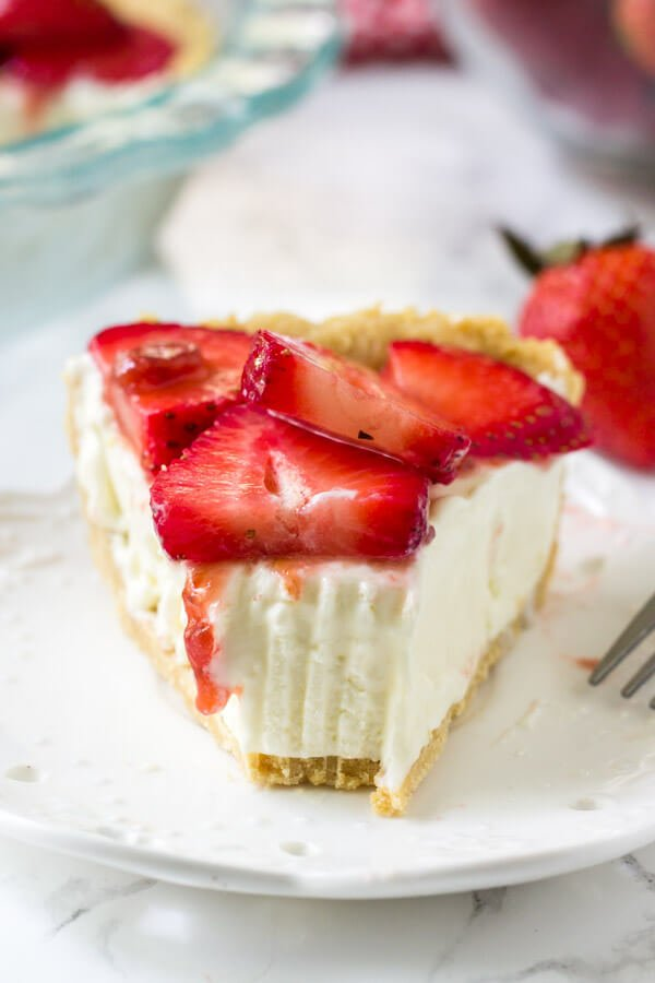 Strawberry Cream Cheese pie is creamy, smooth, and topped with so many fresh berries.