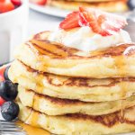These lemon pancakes have a deliciously bright & sunny flavor thanks to fresh lemon juice and lemon zest. They're extra fluffy with golden edges, and taste delicious with summer berries or syru