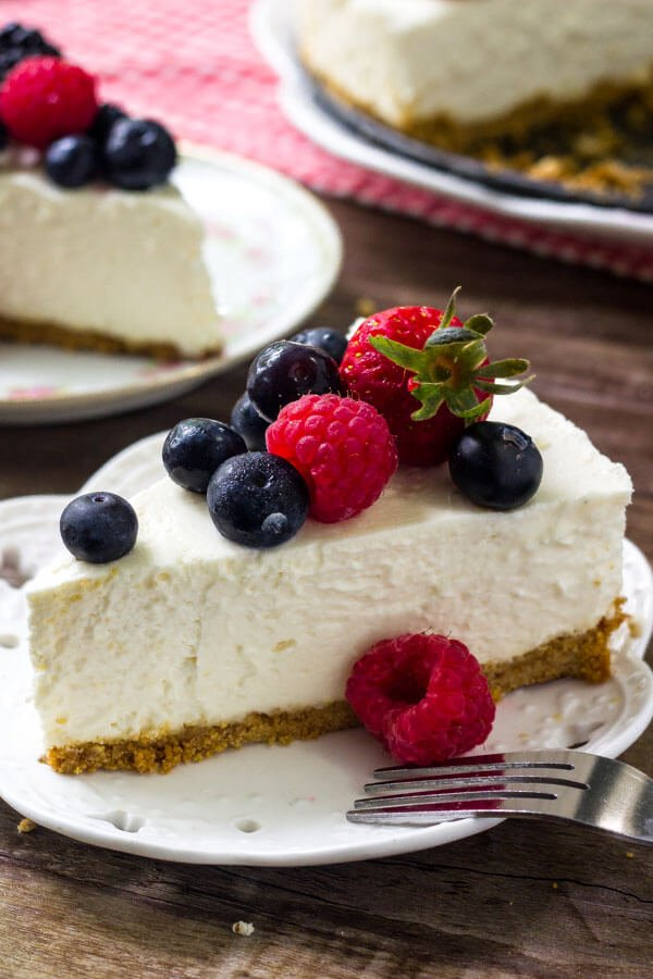 This easy no bake cheesecake is smooth, creamy, and extra delicious. It has all the flavor of a traditional cheesecake - but with way less effort.