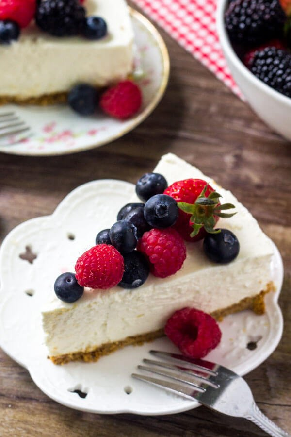 A slice of no bake cheesecake with fresh berries on top makes for the perfect easy summer dessert.