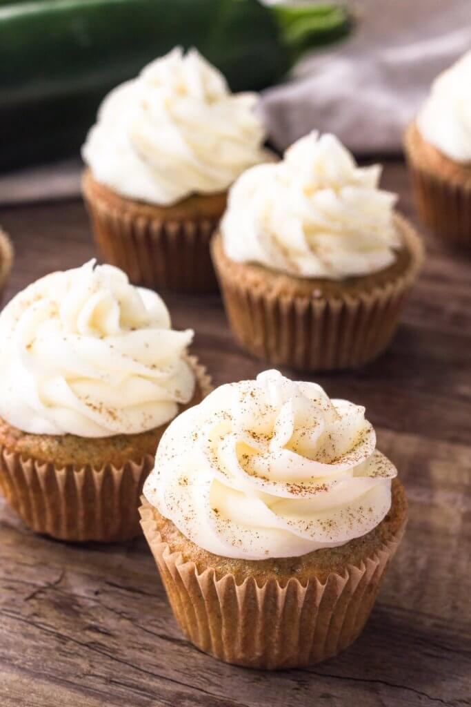 These zucchini cupcakes with cream cheese frosting are extra moist with a delicious spice cake flavor. They're a delicious cupcake recipe for using all the zucchini in season.