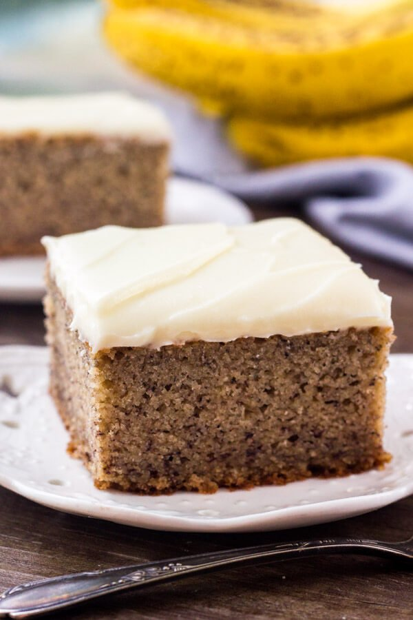Easy banana cake recipe - so moist, and tastes like a slice of banana bread topped with cream cheese frosting.