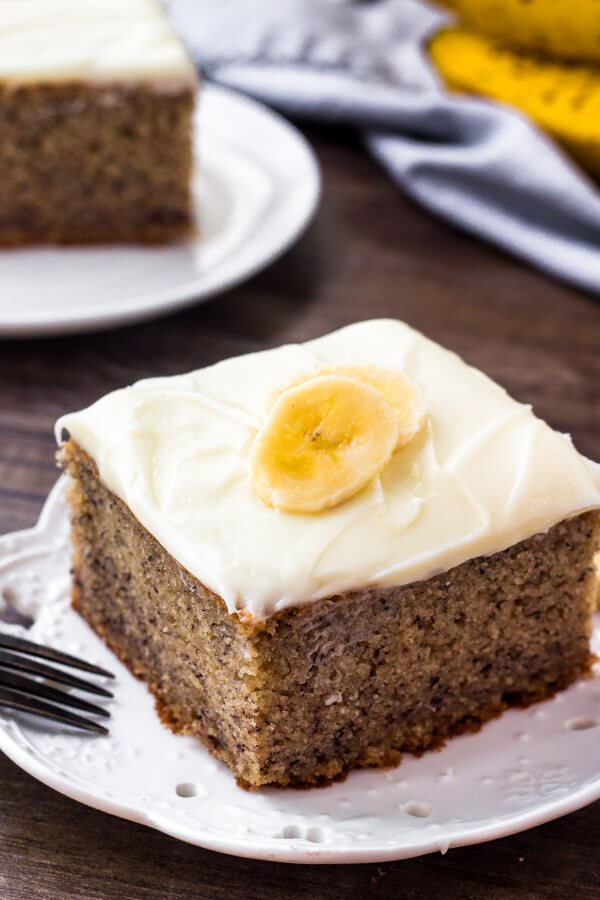 This banana cake is moist, tender, infused with banana, and topped with fluffy cream cheese frosting.