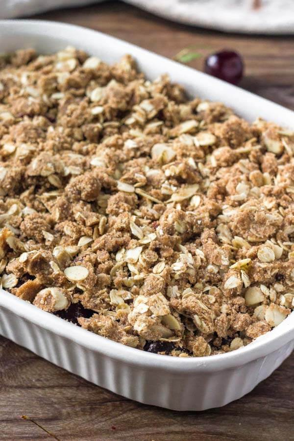 Cherry crumble has sweet cherries and is topped with an oatmeal almond crumble.