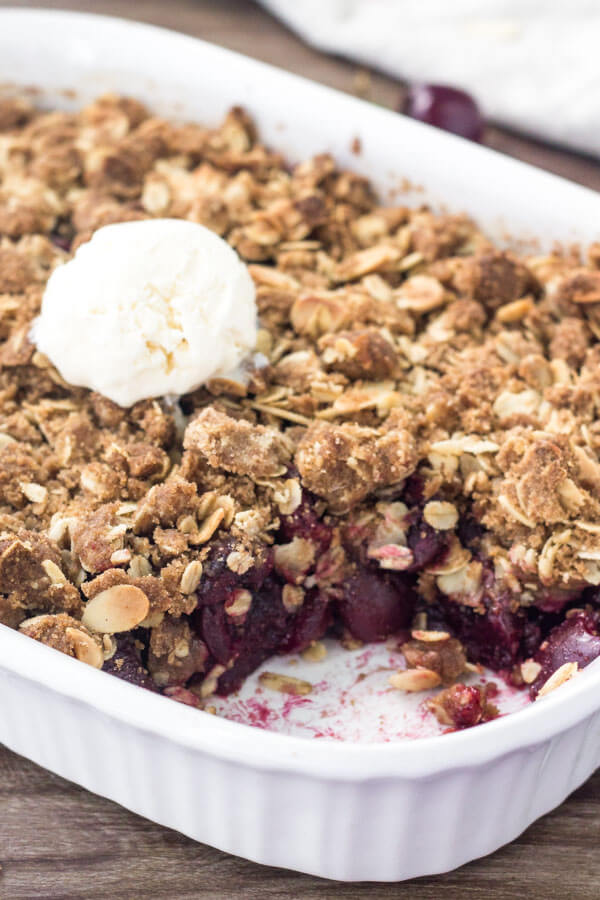 Fresh cherry crisp with juicy berries & oatmeal almond crumble topping.