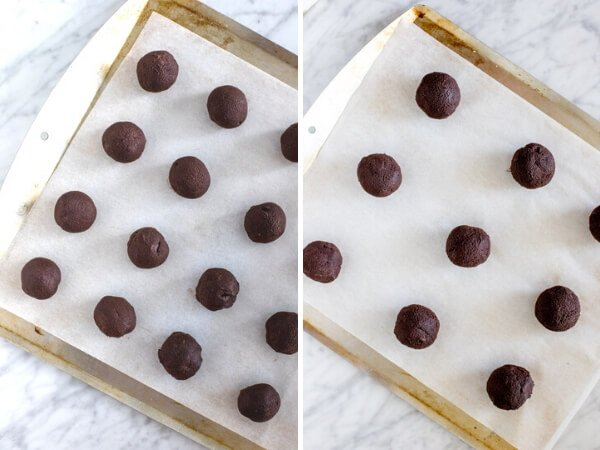 2 different sizes of cookie dough balls on lined cookie sheets