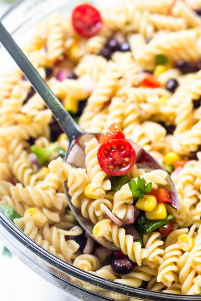 Southwest pasta salad is an easy, delicious recipe for all your summer BBQs and potlucks. It's filled with veggies, corn, black beans & cilantro with a delicious chilli lime vinaigrette dressing.