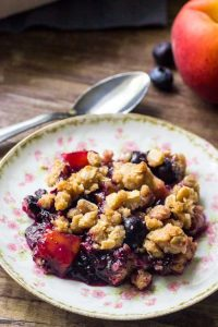 This blueberry peach crumble is the filled with delicious summer fruit with delicious crumble topping.
