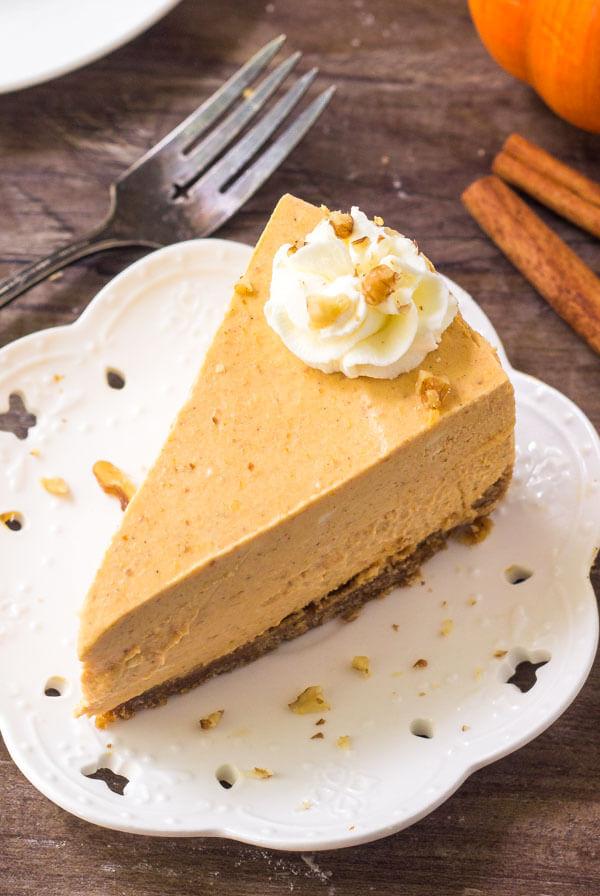 A slice of creamy pumpkin no bake cheesecake.
