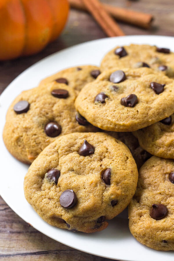 A plate of pumpkin chocolate chip cookies. Learn how to make this easy fall cookie recipe.