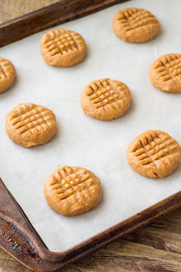Three ingredient peanut butter cookies on a cookie sheet before being baked.