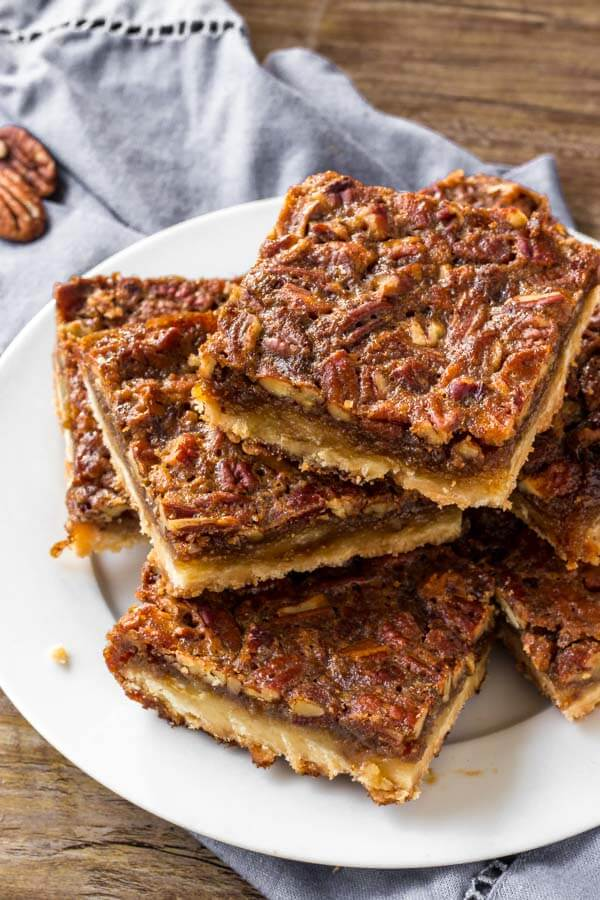 A plate of pecan pie bars.