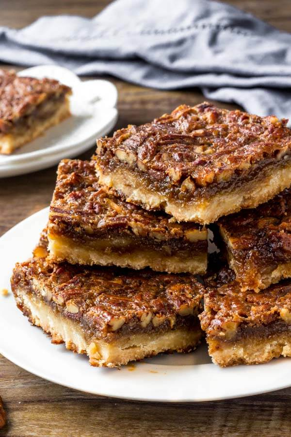 Easy pecan pie bars have a buttery crust, butterscotch flavor & tons of chopped pecans.