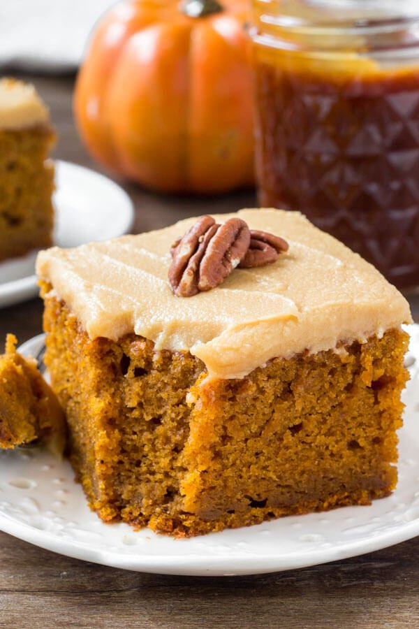 Moist pumpkin cake with caramel cream cheese frosting is so flavorful and perfect for fall.
