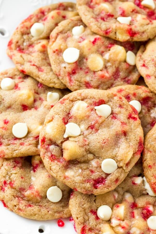 Overhead view of a plate of candy cane white chocolate chip cookies.