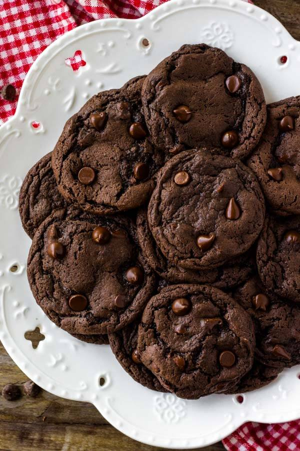 A plate of cake mix chocolate cookies with chocolate chips.