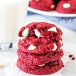 Stack of 4 red velvet cake mix cookies with a glass of milk.