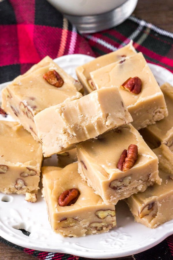 A plate of homemade butter pecan fudge that's sweet, buttery & perfect for the holidays.