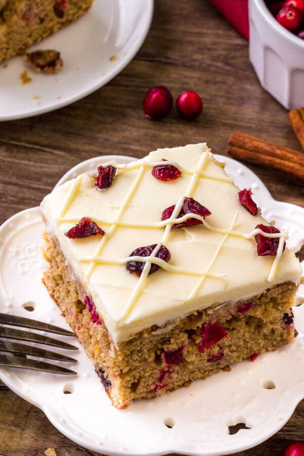 A slice of cranberry christmas cake -made with cinnamon, brown sugar, orange zest and fresh cranberries.