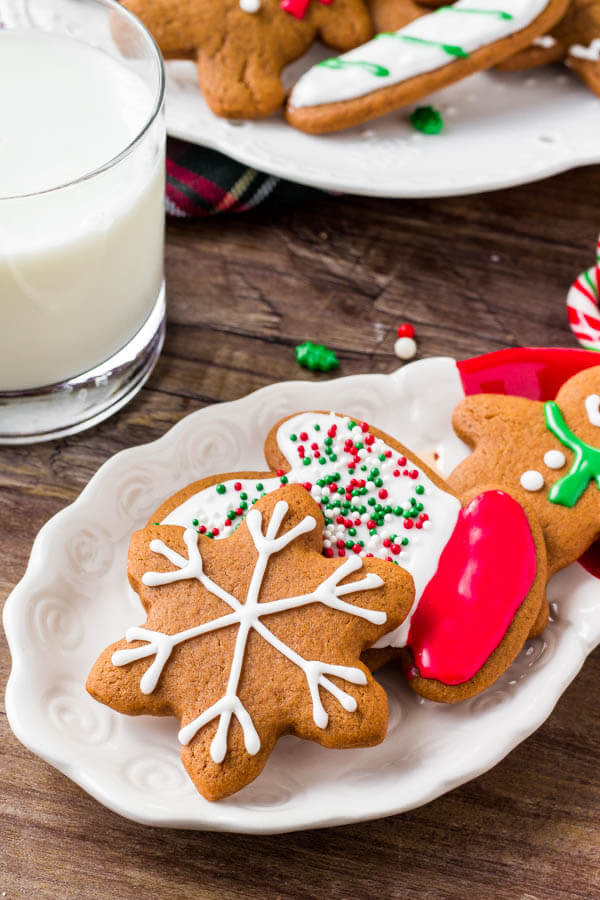 A plate of soft gingerbread cookies decorated with royal icing - learn all the tricks for making the best gingerbread.