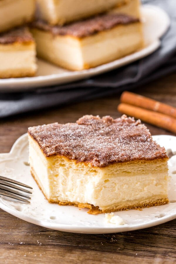 Sopapilla cheesecake with 2 layers of flaky pastry and cinnamon sugar topping.