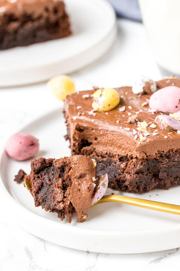 Close up shot of a mini egg brownie with a bite taken out of it.