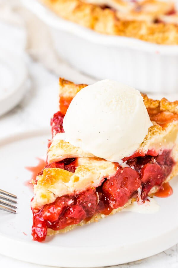 Homemade strawberry pie is an old-fashioned favorite. Sweet, juicy strawberries, flaky pastry and a scoop of vanilla ice cream make this baked strawberry pie the perfect dessert for strawberry season.