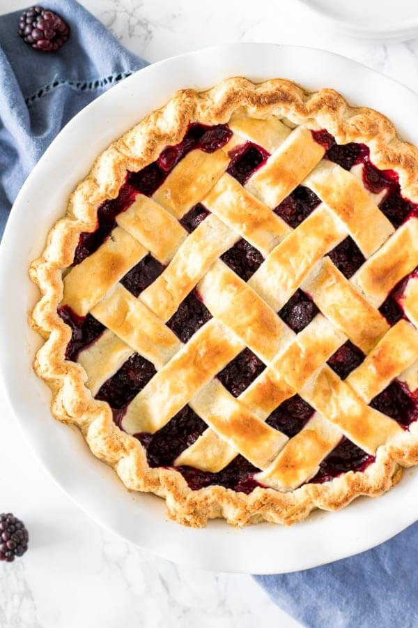 Baked blackberry pie with a lattice top. Made from scratch with flaky pastry crust.