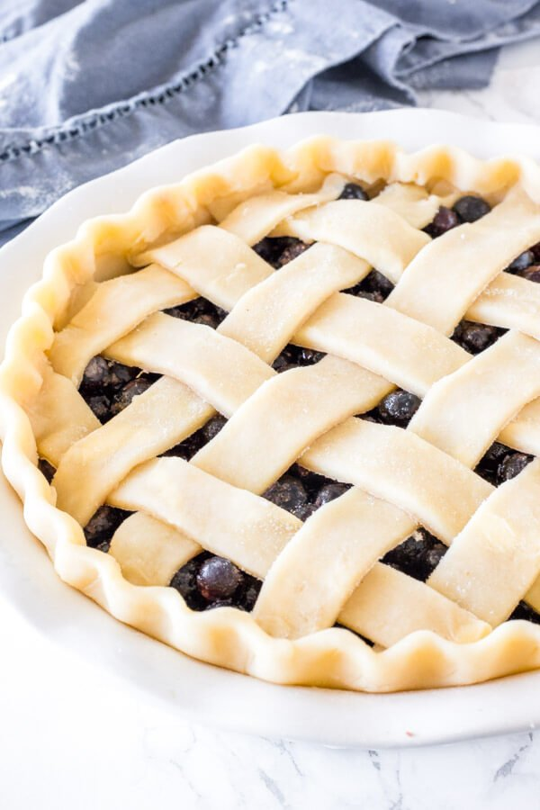 Homemade pie with a lattice crust and fluted edges.