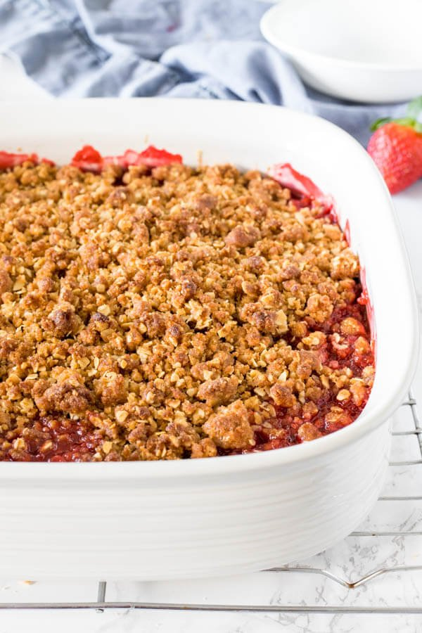 The pan of strawberry rhubarb crisp fresh from the oven with the fruit filling just starting to bubble underneath the oatmeal topping.