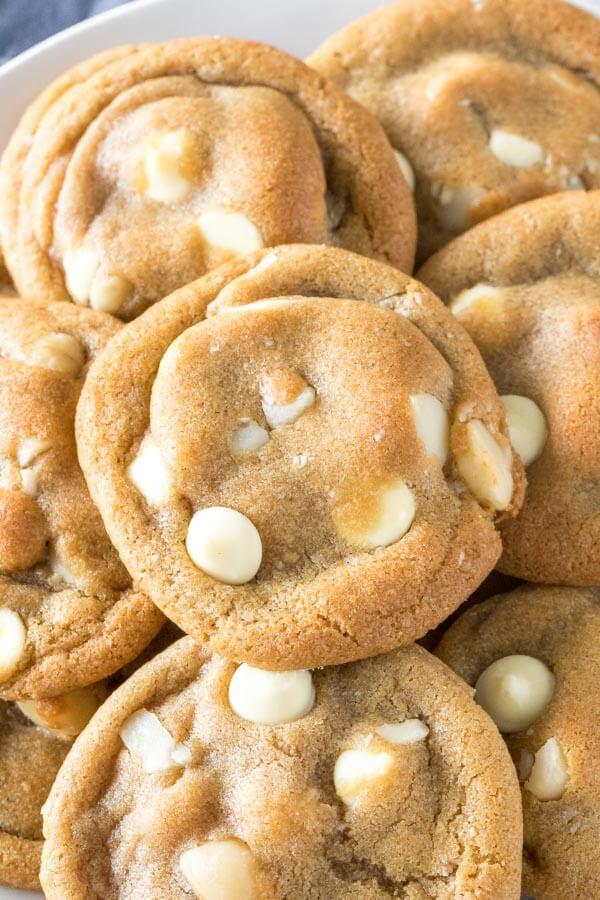 Overhead shot of a plate of white chocolate macadamia nut cookies.